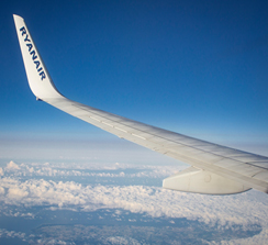An airplane wing above clouds Description automatically generated with low confidence